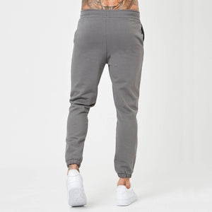 Back profile of mens branded grey joggers