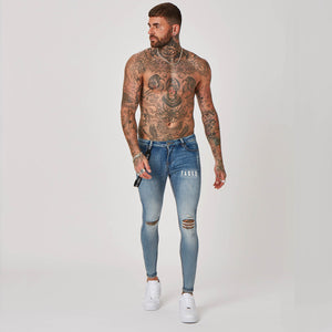 model wearing antique wash jeans