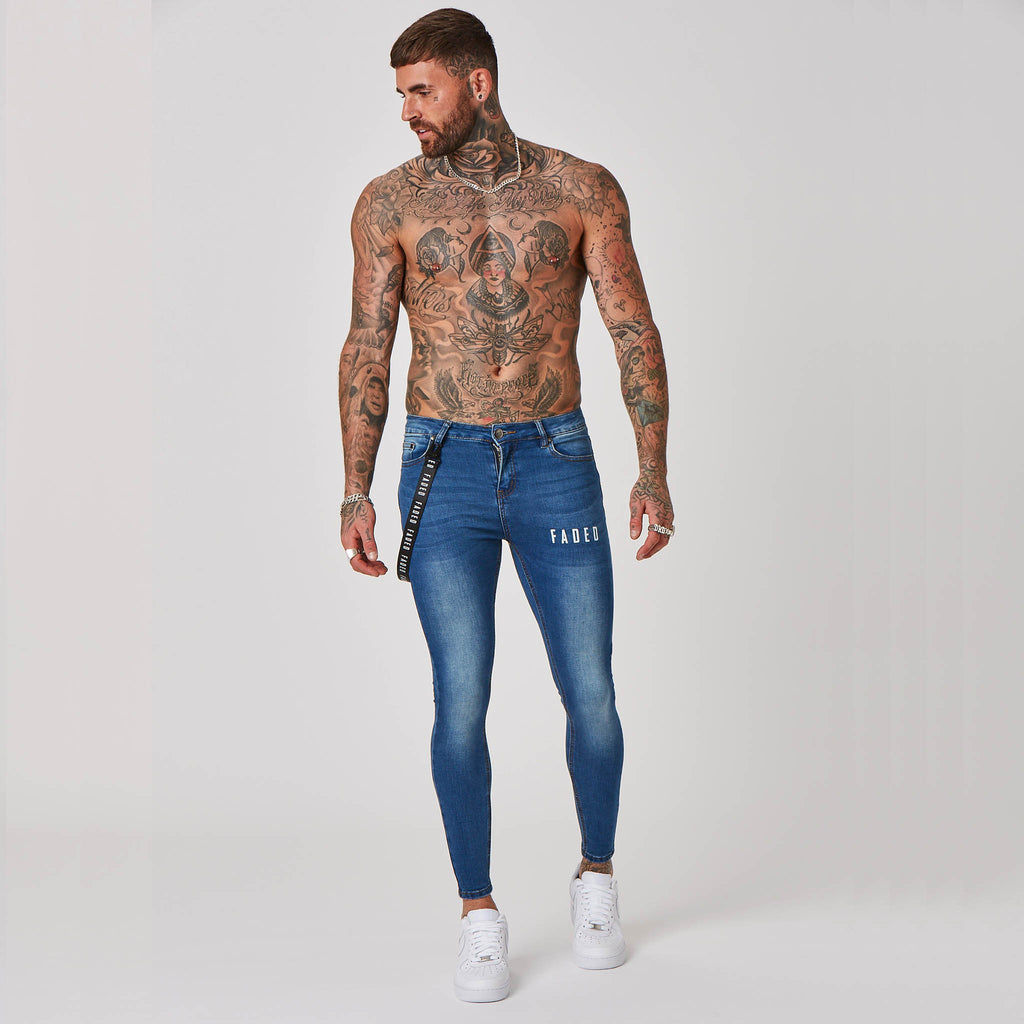 Male model wearing Faded spray on jeans