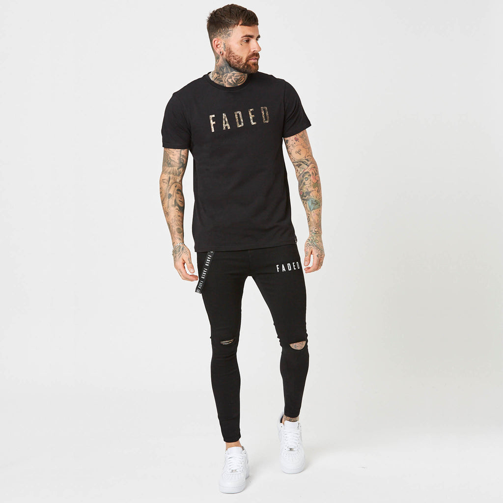 model wearing black streetwear t-shirt and jeans