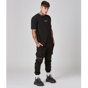 Chet Sket in black Faded Utility wear