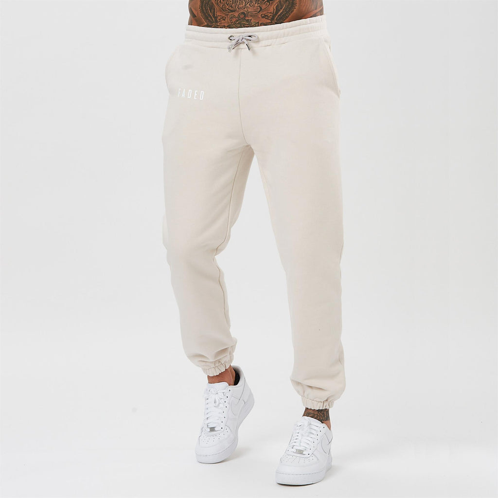 male model wearing joggers from the mens full tracksuit in the colour ecru