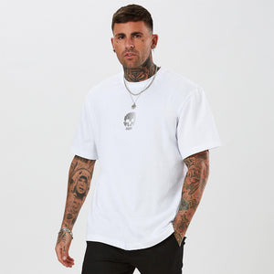 Mens oversized white t-shirt with small skull graphic