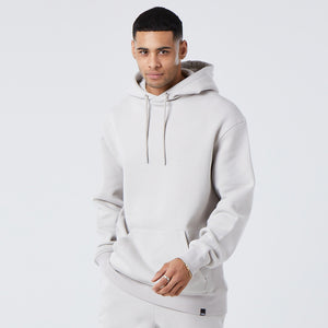 male model wearing basic mens hoodie in light grey