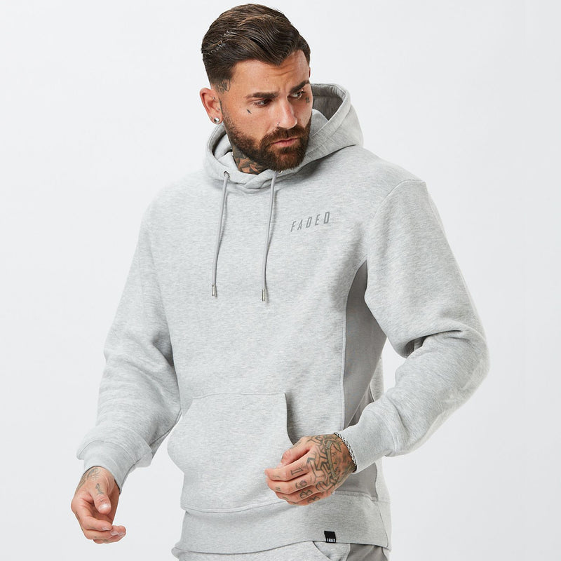 model wearing panelled mens full tracksuit in grey