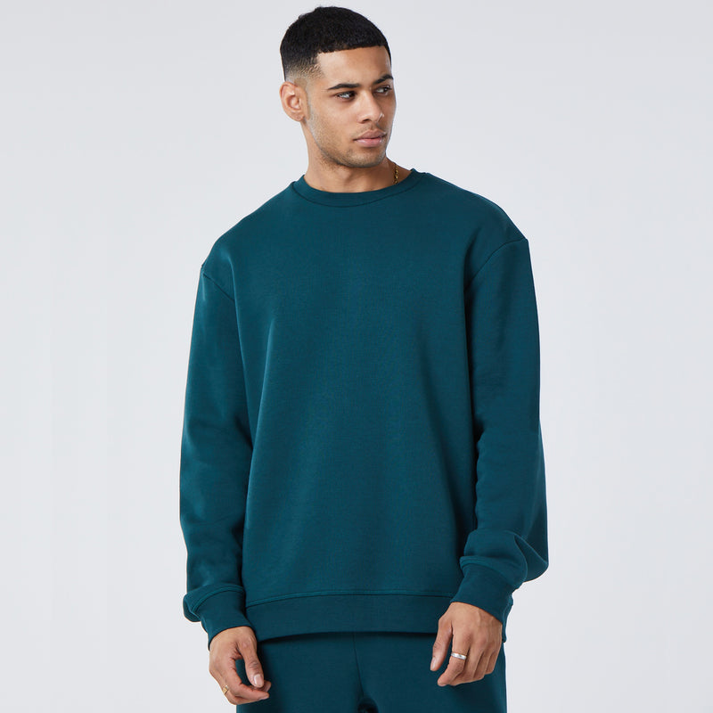 front profile of model in green mens plain tracksuit