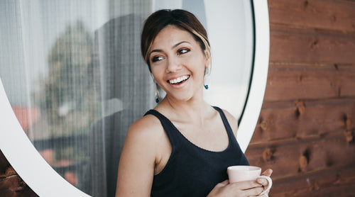 woman-smiling-holding-coffee