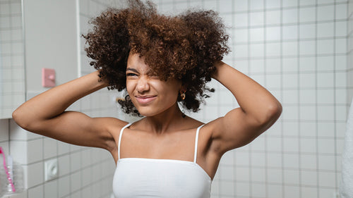 woman fluffing hair with hands