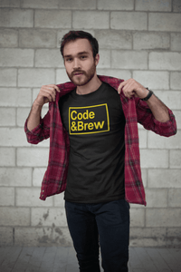 guy wearing a code and brew black t-shirt with yellow text