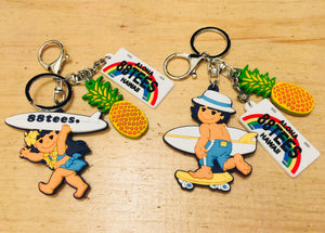 SURFER GIRL AND BOY PINEAPPLE KEYCHAIN