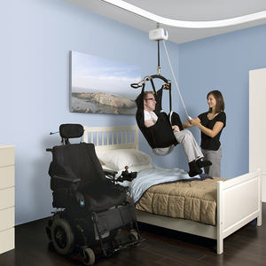 Handicare Prism Medical C-300 Fixed Ceiling Lift in use