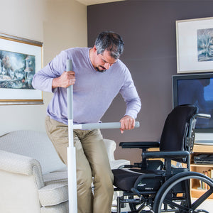 HealthCraft Advantage Rail wheelchair user transferring to chair – Home Safety Solutions | VIVA Mobility
