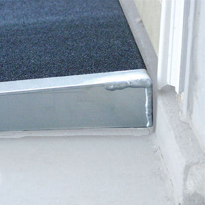 PVI Self-Supporting Solid Surface Threshold Ramp at doorway  | VIVA Mobility
