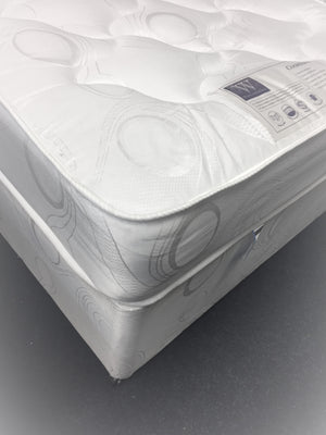 Features: Comfort level - Medium tension; Bonnell spring unit with steel rod-edge; Multi-quilted layers of poly-cotton filling; Woven damask cover; Base fabric matches mattress