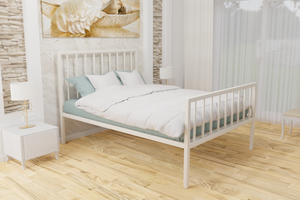 The Pinner Wrought Iron Bed Frame, is pictured here in ivory with a high foot end style.  It has sleek, straight lines and a very strong steel mesh base backed by a 5 year guarantee