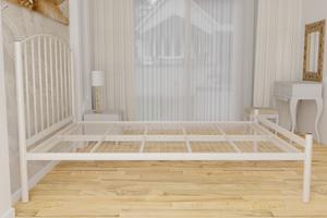 The Stanmore Wrought Iron Bed Frame, is pictured here in ivory with a low foot end style.  It has sleek lines, curves and a very strong steel mesh base backed by a 5 year guarantee
