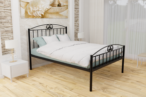 The Holly Wrought Iron Bed Frame, pictured here in black with a high foot end style.  It has decorative features to the head and foot ends, together with a very strong steel mesh base backed by a 5 year guarantee