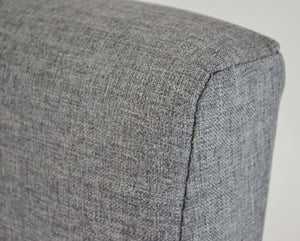 Houston Ottoman Storage Bed Frame, close up of the head end covered in Grey fabric