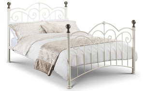 The Isla White Metal Bed Frame is a timeless, classic bed suitable for almost any bedroom design. It is constructed from powder coated steel, with beautiful castings, finished in stone white with brass plated finials.