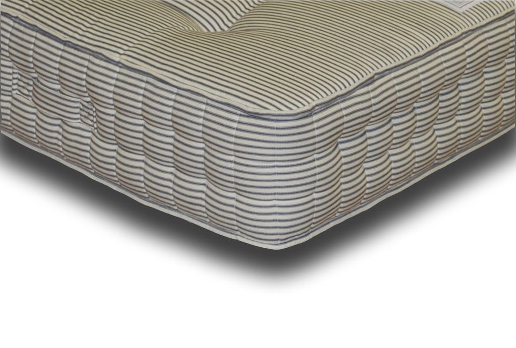 The Pocket Deluxe 2000 mattress features:  2000 Hand nestled pocket springs topped with generous hand-filled and tufted, multi-quilted layers of luxury cotton fillings; Covered in a Contract quality blue and white stripe Source 5 cotton fabric