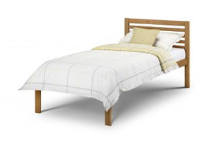 The Ranch Single Bed pictured here in Antique Pine finish, is a modern style wooden frame with a sprung slatted base