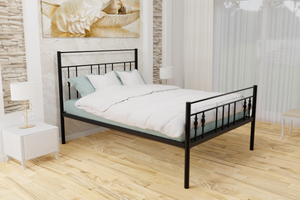 The Yiewsley Wrought Iron Bed Frame, pictured here in black with a high foot end style.  It has decorative features to the head and foot ends, together with a very strong steel mesh base backed by a 5 year guarantee