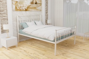 The Yiewsley Wrought Iron Bed Frame, pictured here in ivory with a high foot end style.  It has decorative features to the head and foot ends, together with a very strong steel mesh base backed by a 5 year guarantee