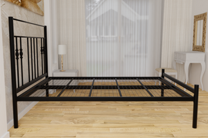 The Yiewsley Wrought Iron Bed Frame, pictured here in black with a low foot end style.  It has decorative features to the head end and a very strong steel mesh base backed by a 5 year guarantee