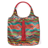 COLOURING BOOK DOODLE PRINT VELVET TOTE WITH RED FAUX LEATHER  HANDLES AND TASSELLED TOP CLOSURE