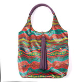 COLOURING BOOK DOODLE PRINT  VELVET TOTE WITH PURPLE FAUX LEATHER  HANDLES AND TASSELLED TOP CLOSURE