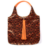 GOLDEN PEACOCK FEATHER PRINT VELVET TOTE BAG WITH ORANGE FAUX LEATHER HANDLES AND TASSELLED TOP CLOSURE