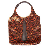 GOLDEN PEACOCK FEATHER PRINT VELVET TOTE BAG WITH CHOCOLATE BROWN FAUX LEATHER HANDLES AND TASSELLED TOP CLOSURE