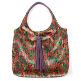 MULTICOLOUR ILLUSTRATED FEATHER PRINT VELVET TOTE WITH PURPLE FAUX LEATHER  HANDLES AND TASSELLED TOP CLOSURE