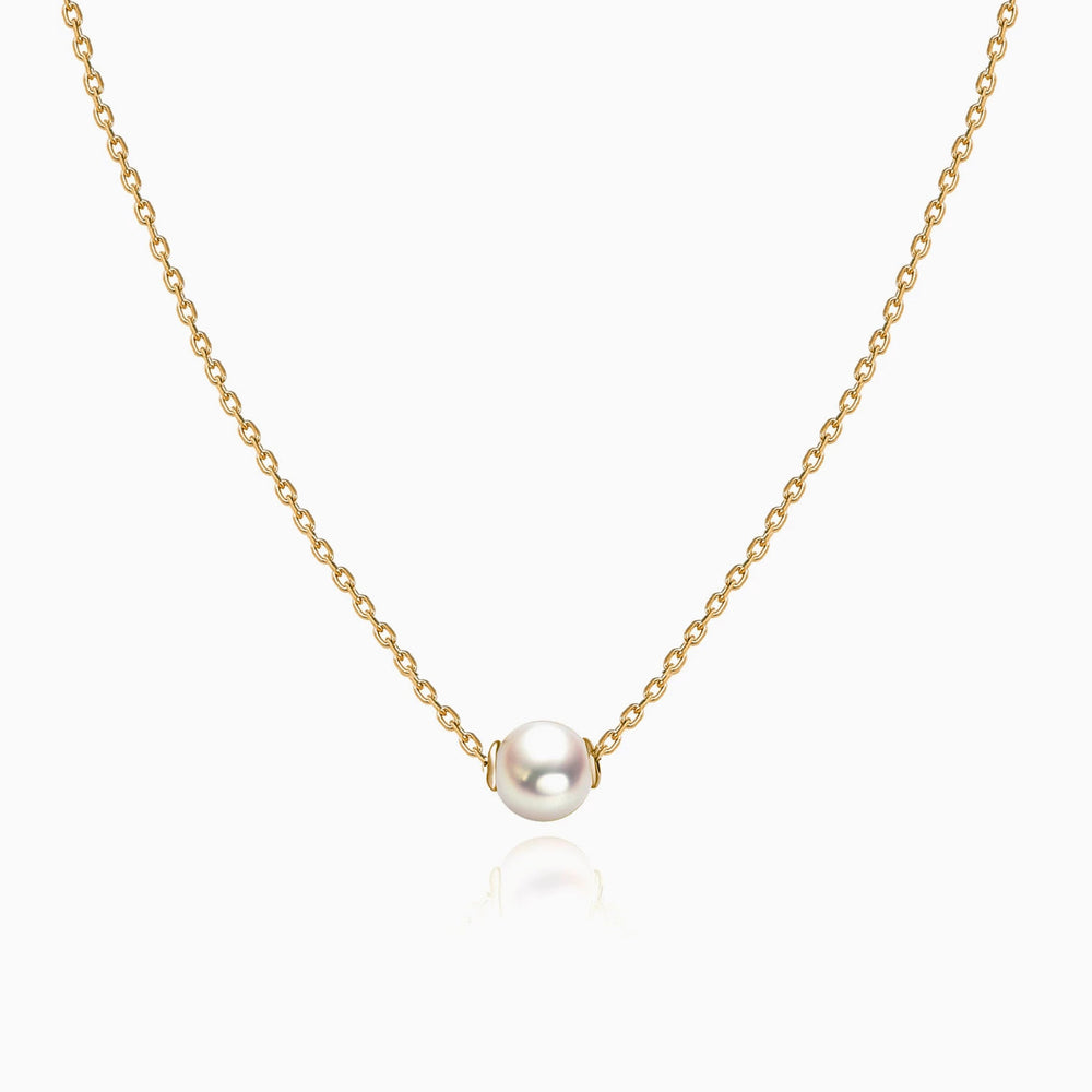 white pearl necklace gold