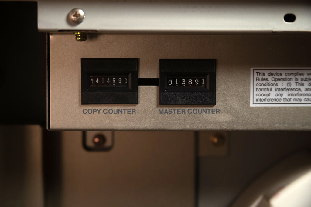 Photograph of the Diskette Press Risograph's copy counter and master counter. The machine has made over 4.4 million copies, and over 13 thousand masters.