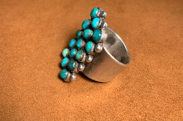 Fifteen Stone Turquoise Ring by Jock Favour