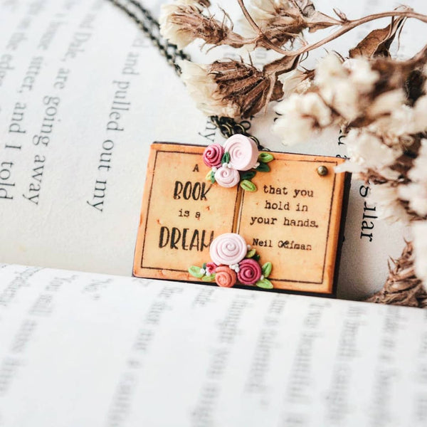 A Book is a dream that you hold in your hands. - Neil Gaiman Quote Book Page Pendant