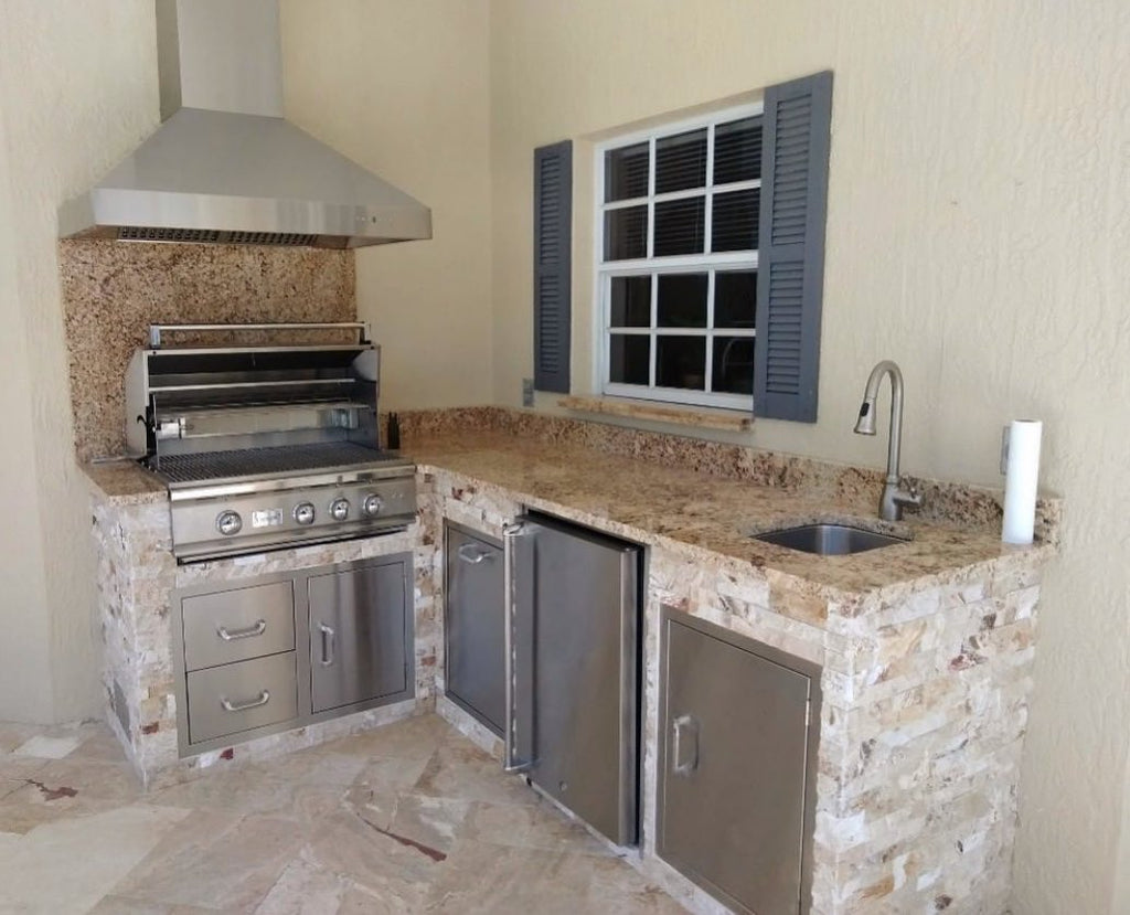 Compact Gourmet Kitchen with Hood with Gorgeous Earth Tones for Year-Round Grilling in Port Charlotte, Florida