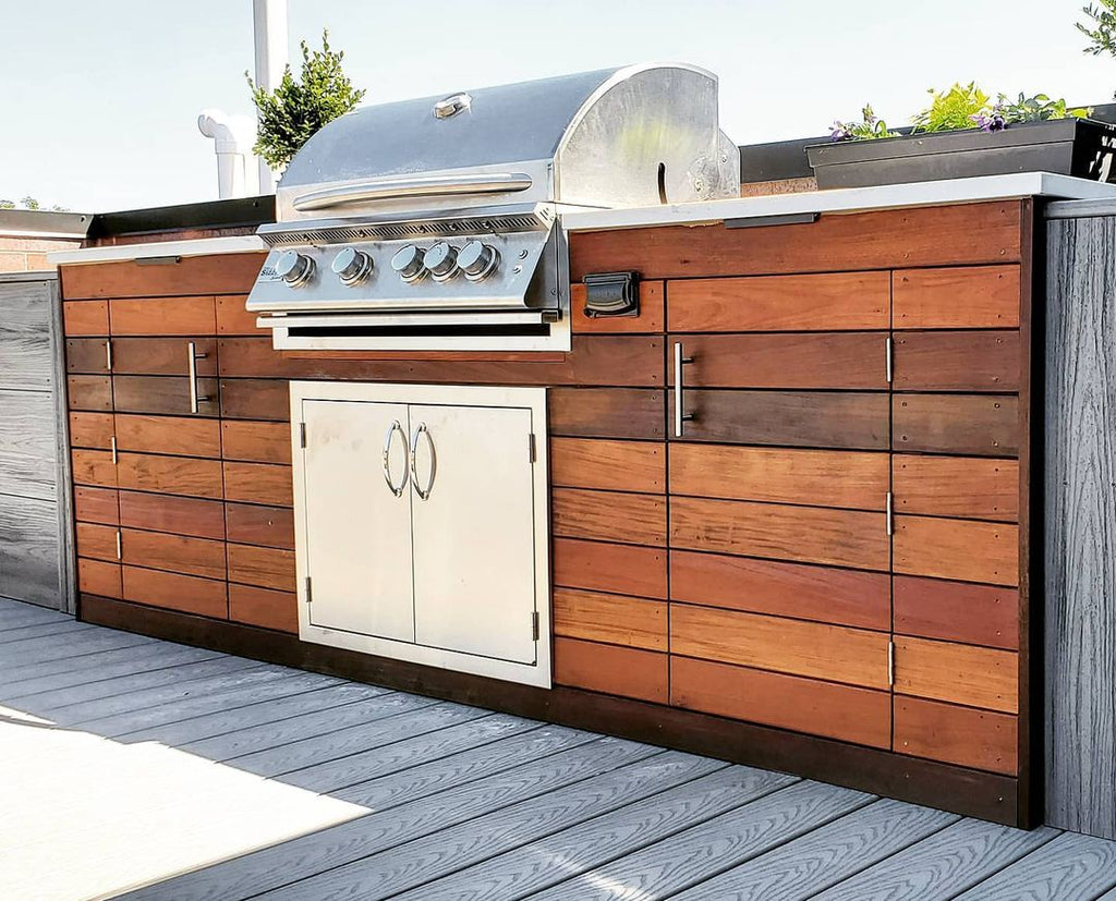 Custom Chicago Rooftop Retreat with Luxurious Hardwood, White Pergola, and Modern Grill Island