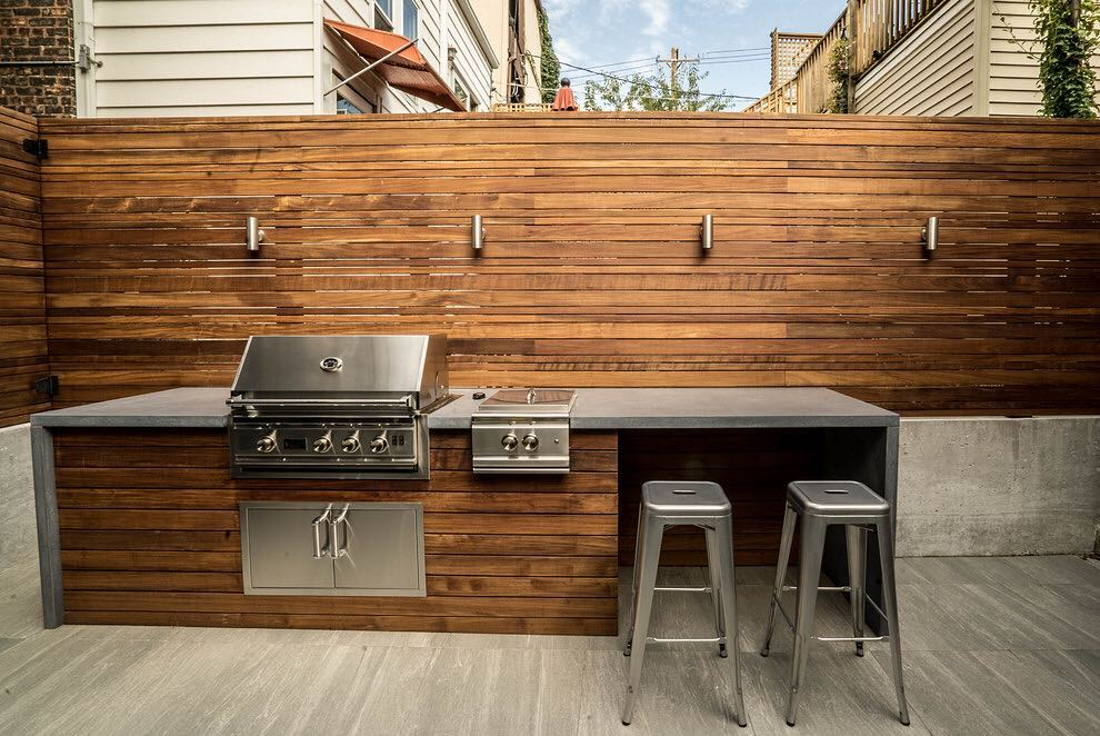 Warm & Modern Coastal Grilling Hideaway with Gorgeous Wood Slatting and Waterfall Counters