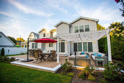 Sleek Kitchen, Charming Pergola, Warm Herringbone Deck, Outdoor Getaway Wide View
