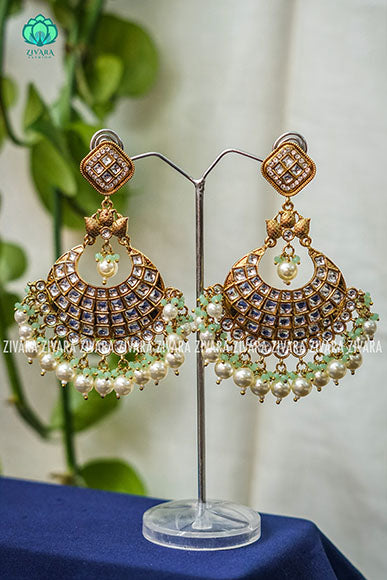 White kundan and pastel beads -Mayura collection- Grand and vibrant party wear and bollywood bridal earrings- Zivara fashion