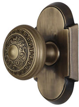 2 Inch Egg and Dart Door Knob With Arched Rosette