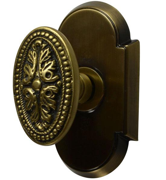 Solid Brass Avalon Oval Door Knob Set With Arched Rosette