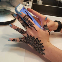Load image into Gallery viewer, fresh jagua traditional hand mehndi design on girl holding iphone.