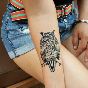 fresh jagua ink realistic looking temporary owl tattoo on girl with shorts..