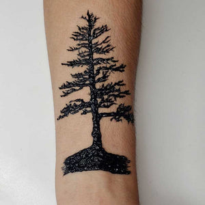 Jagua henna pine tree temporary tattoo made with fresh jagua gel.