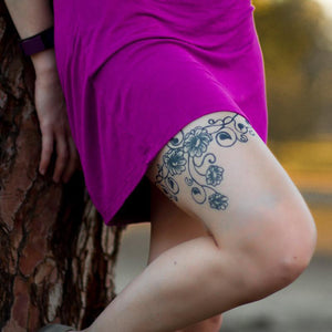 Flower vine jagua ink tattoo on girls leg