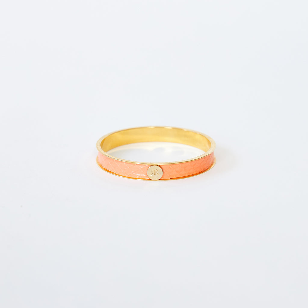 Brass bangle with sherbet sea snake inlay