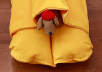 small yellow dog bed with a pocket for burrowing, with a dachshund stuffed animal